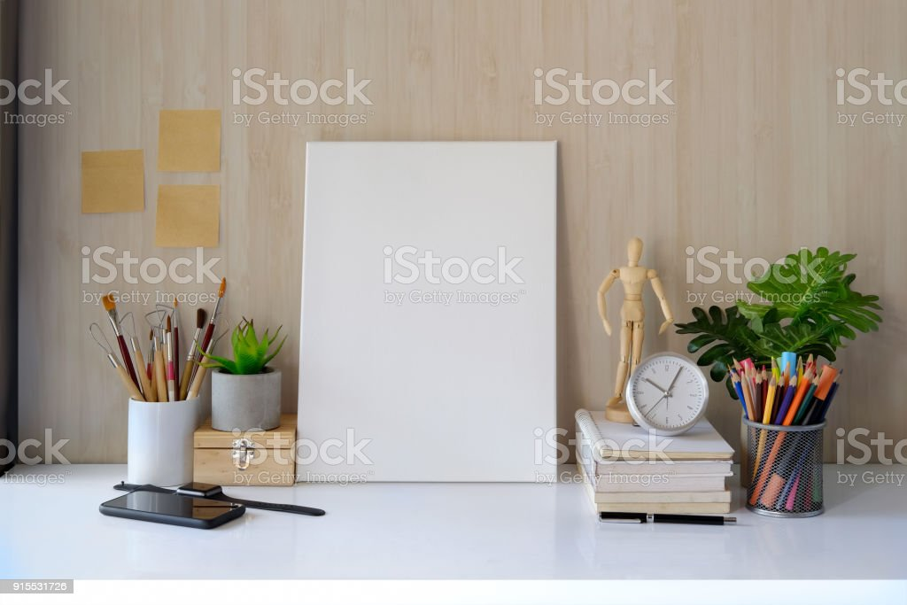 Mockup workspace and poster and artist craft accessories on desk. stock photo