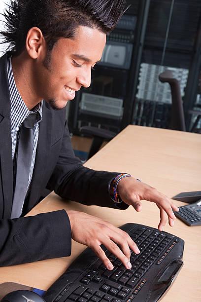 Mod businessman working at desk stock photo