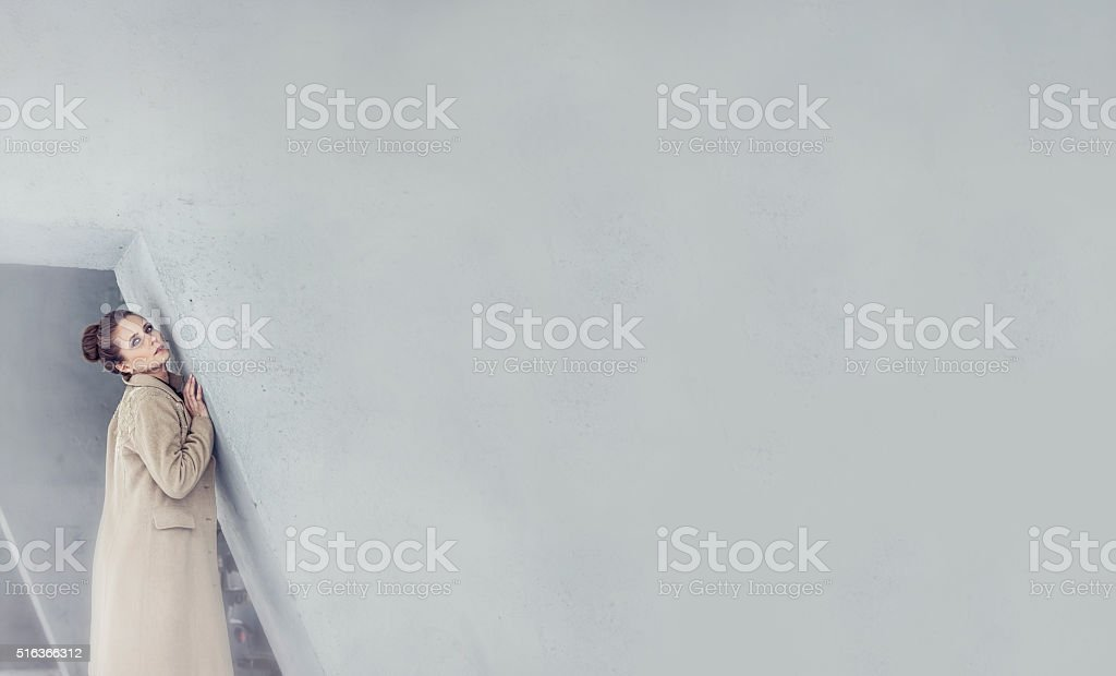 Model a beautiful woman in a fashionable coat stock photo