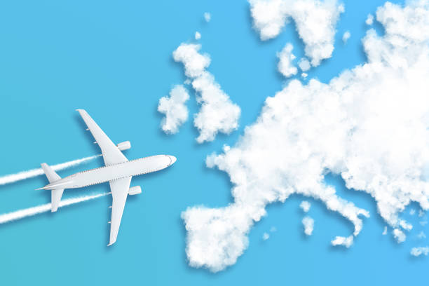 Model airplane design miniature blue background fluffy clouds in the shape of continent Europe. The idea of tickets for the trip, traveling by plane, new discoveries, summer holidays stock photo