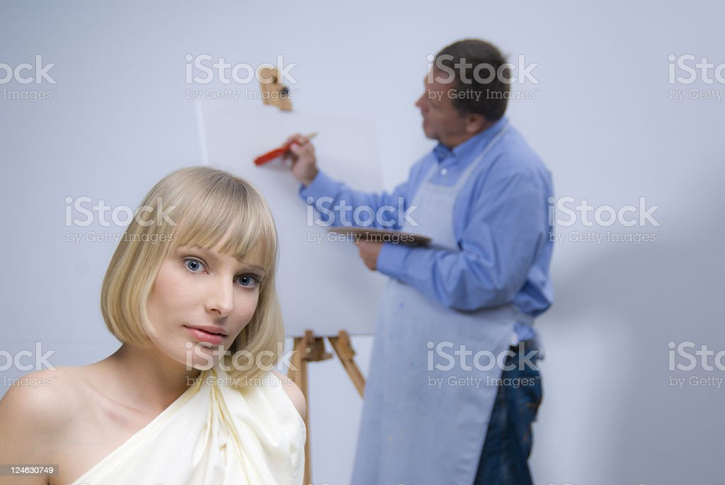 Model and the painter royalty-free stock photo