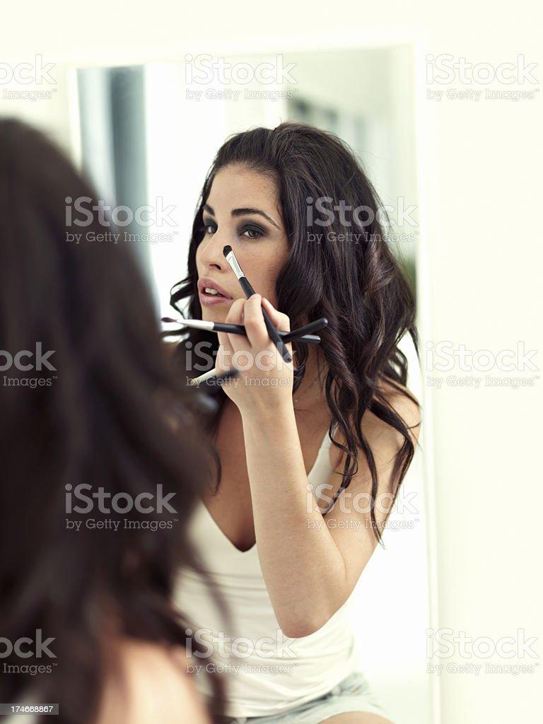 Model applying makeup royalty-free stock photo
