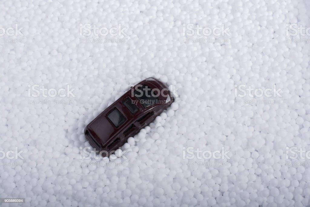 Model car on white polystyrene foam balls stock photo