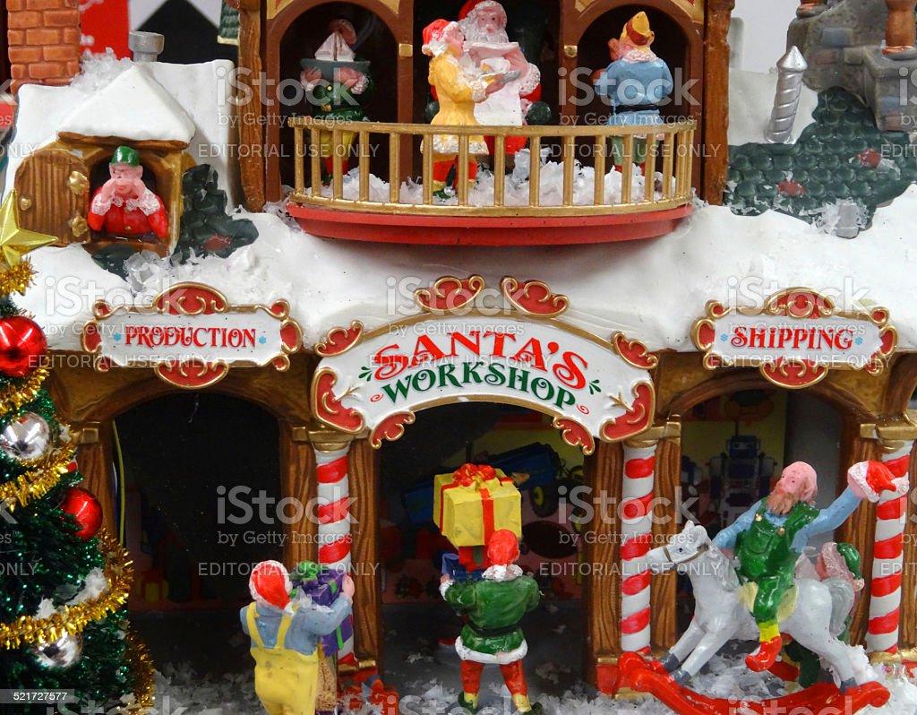 Model Christmas village with miniature houses, people, winter-scene, Santa's workshop stock photo