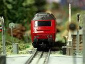 istock Model diesel Locomotive scale H0 passing crossing 157295296