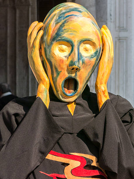 Model dresses as Munch's The Scream at the Venice carnival stock photo