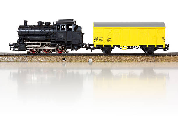 model electric freight train on the rails - modellbahnanlagen stock-fotos und bilder