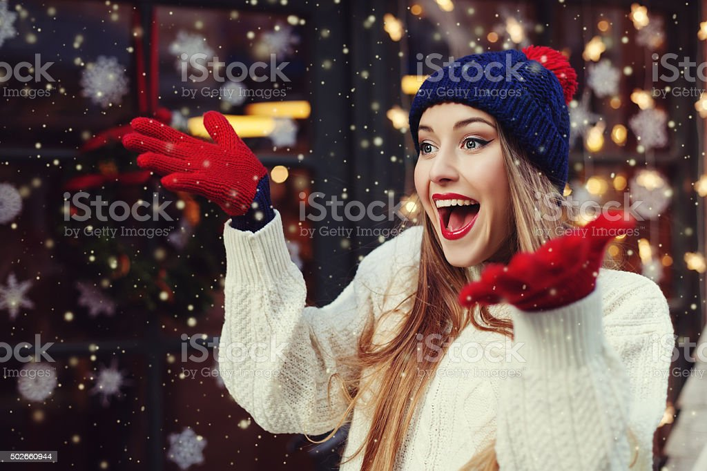 Model expressing joy and excitement with hands and face. stock photo