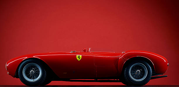 Model Ferrari 375 Plus On Red London, England - July 27, 2016: The side view of a scale model of the 1954 Ferrari 375 Plus against a red background. ferrari stock pictures, royalty-free photos & images