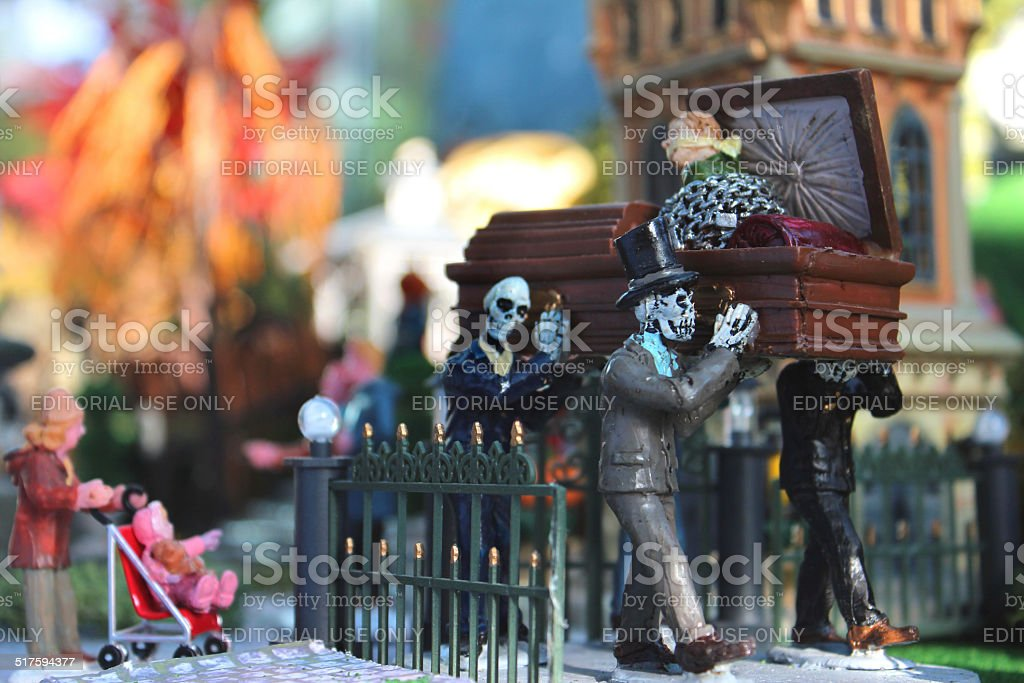 Model Halloween spooky-town / village, miniatures, skeletons carrying coffin, graveyard cemetery stock photo