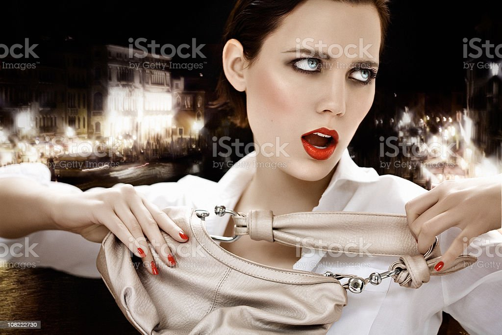 Model Holding Purse at Night royalty-free stock photo
