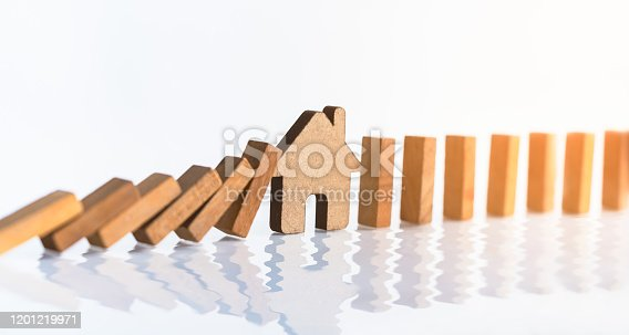915688450 istock photo Model house  amidst  wooden block. 1201219971