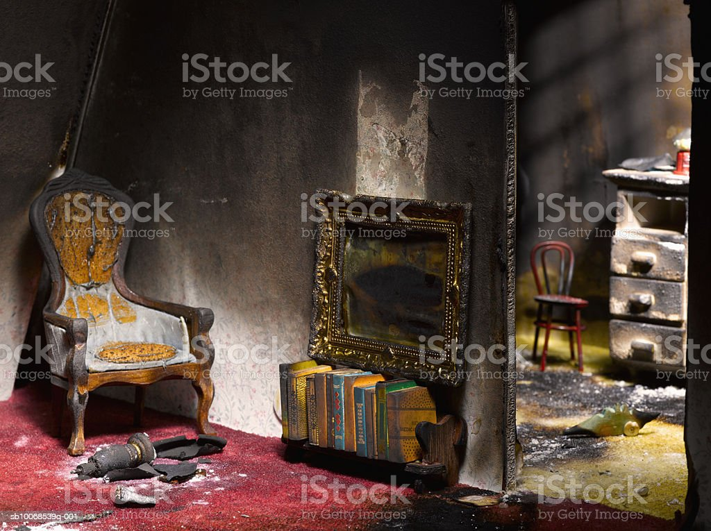 Model house damaged in fire, close-up royalty-free stock photo