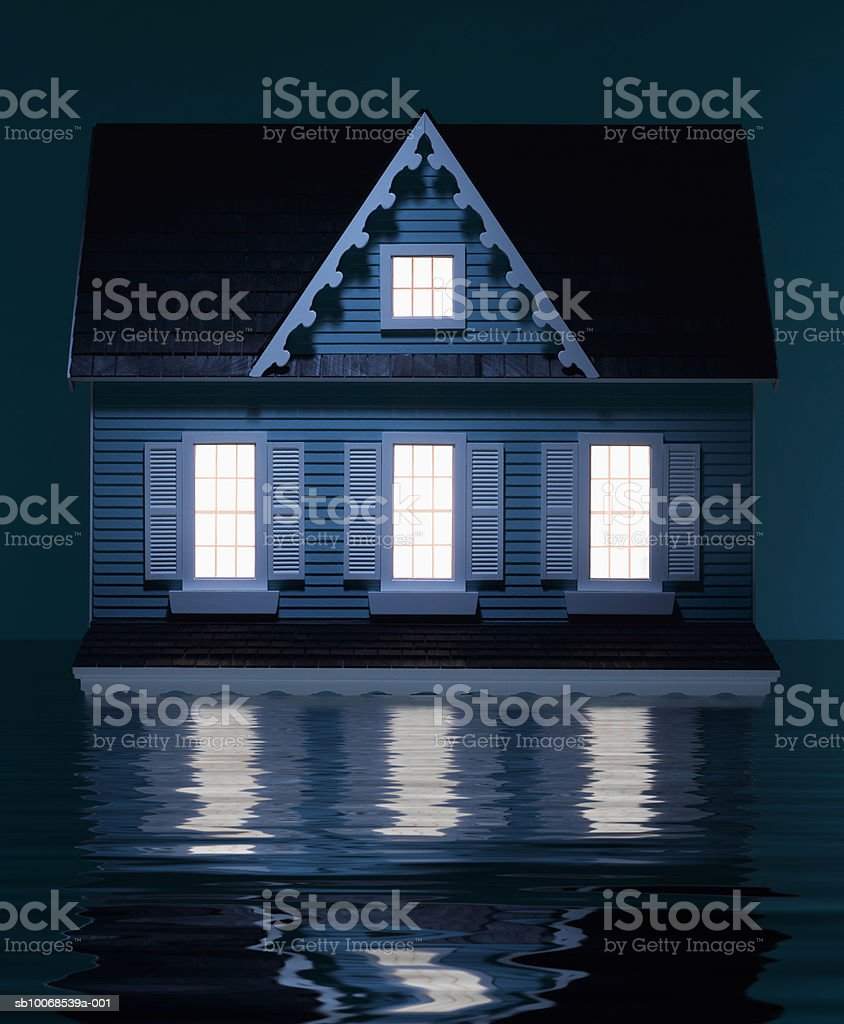 Model house floating in water, close-up royalty-free stock photo