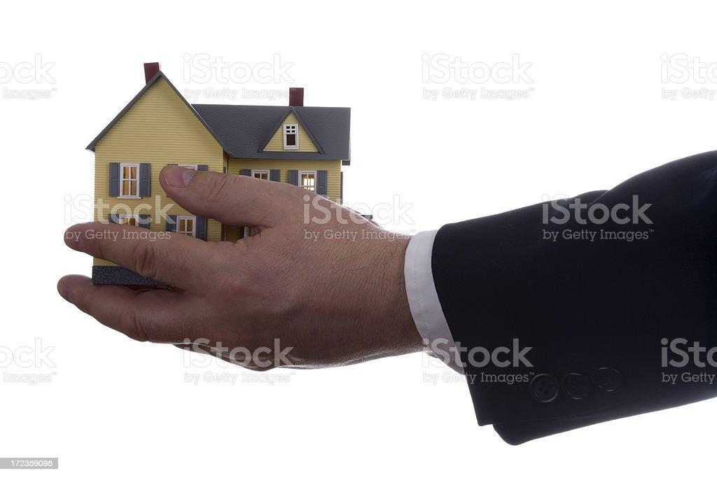 Model house in male hands on white royalty-free stock photo
