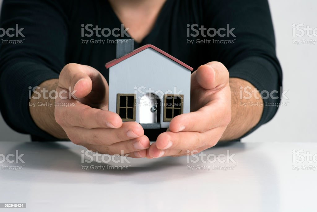 Model house in two hands. royalty-free stock photo