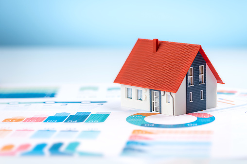Model house on a financial graph high quality and high resolution studio shoot