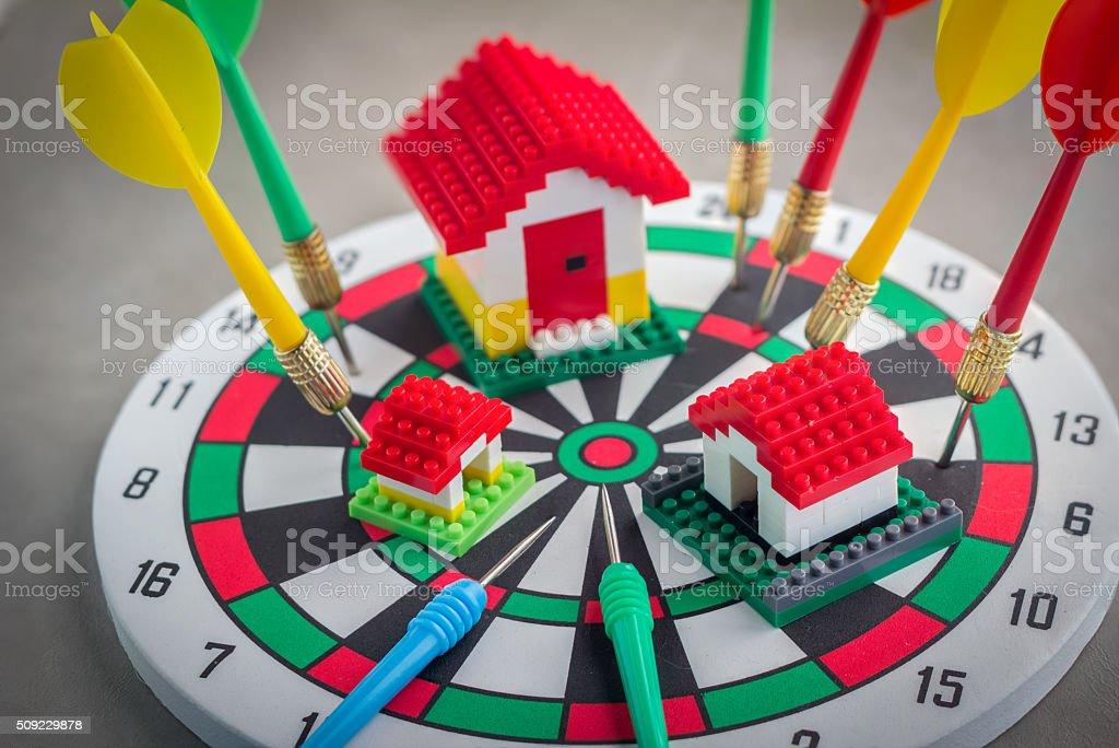 model house on dartboard stock photo