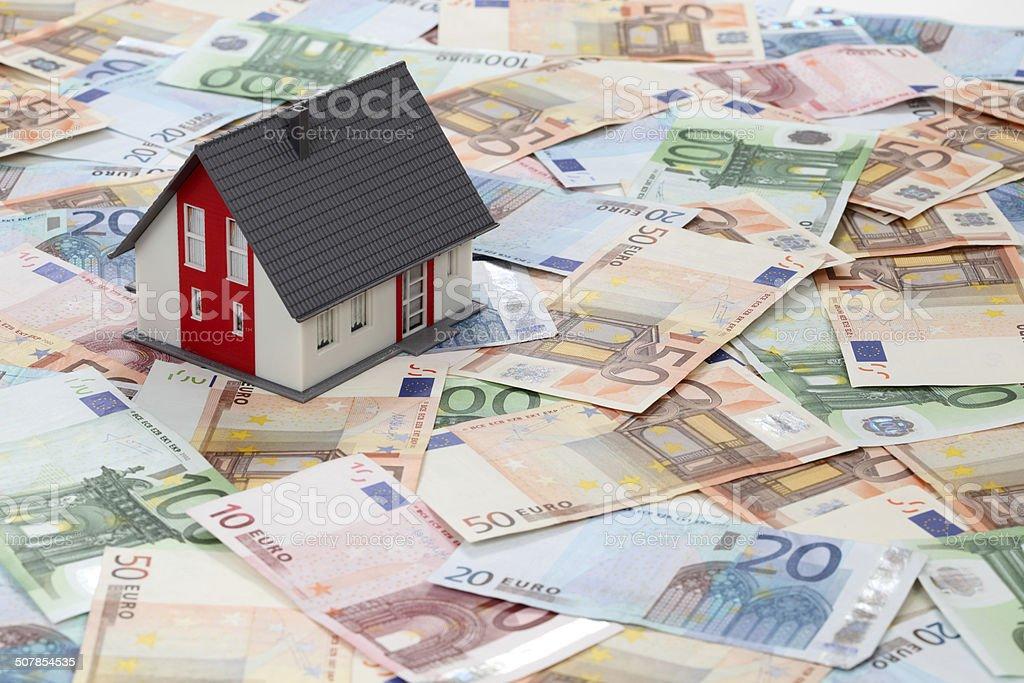 Model house on euro banknotes stock photo