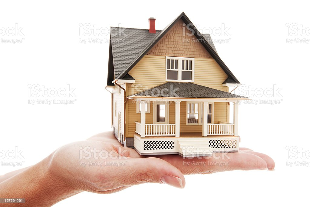 Model house sitting on top of female hand isolated royalty-free stock photo