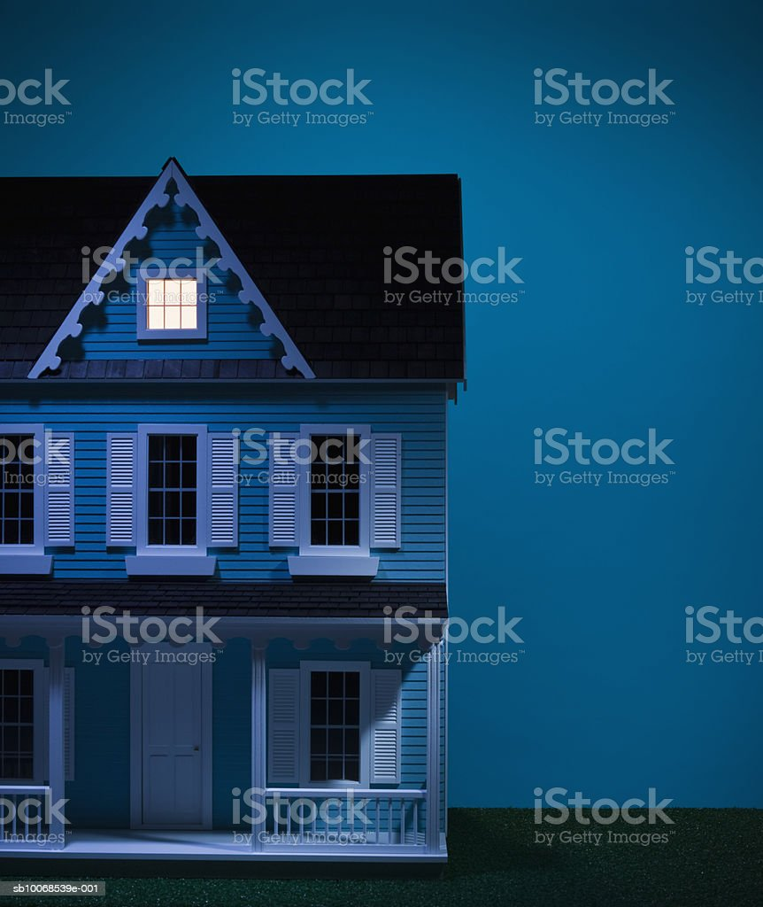 Model house with attic illuminated, close-up royalty-free stock photo