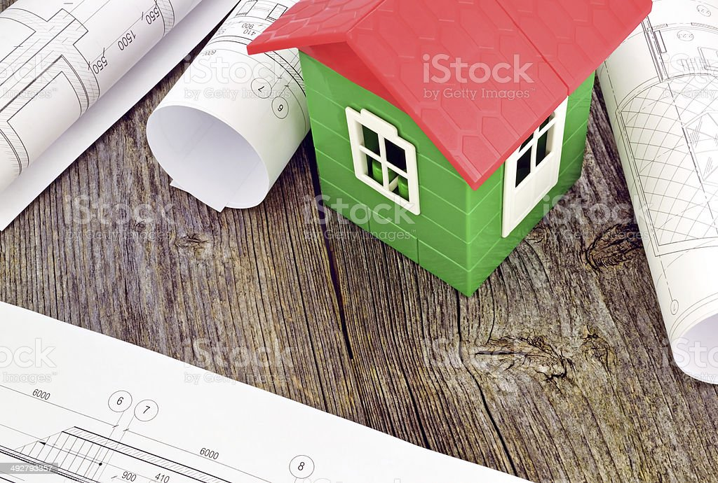 Model house with design drawings stock photo