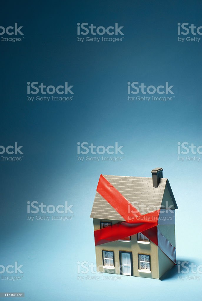 Model house with red tape around it stock photo