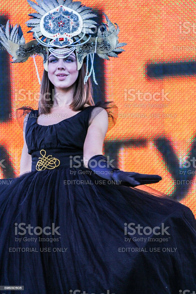 Model in black dress and gold tones. royalty-free stock photo