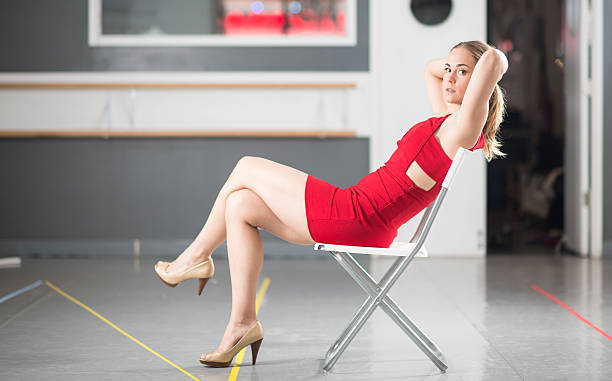 model in red dress - mini dress stock photos and pictures