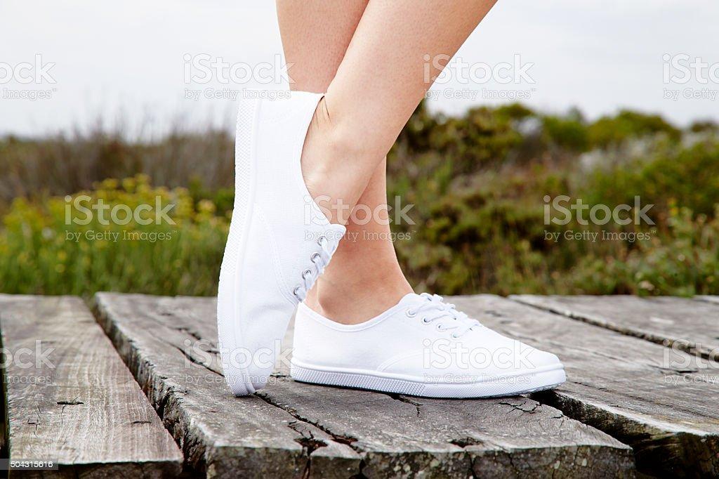 Model in white sneakers stock photo