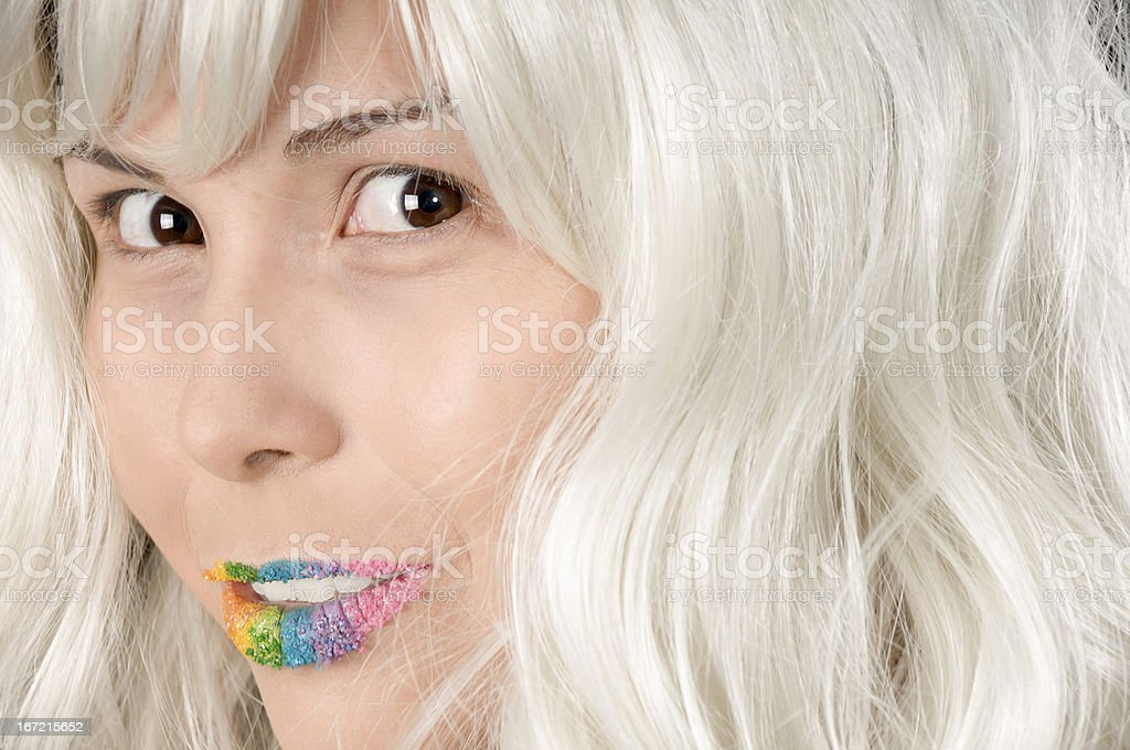 Model in white wig and candy lips with shy smile royalty-free stock photo