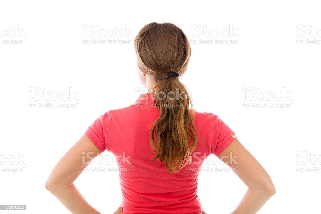 model isolated on plain background back hands on hips stock photo