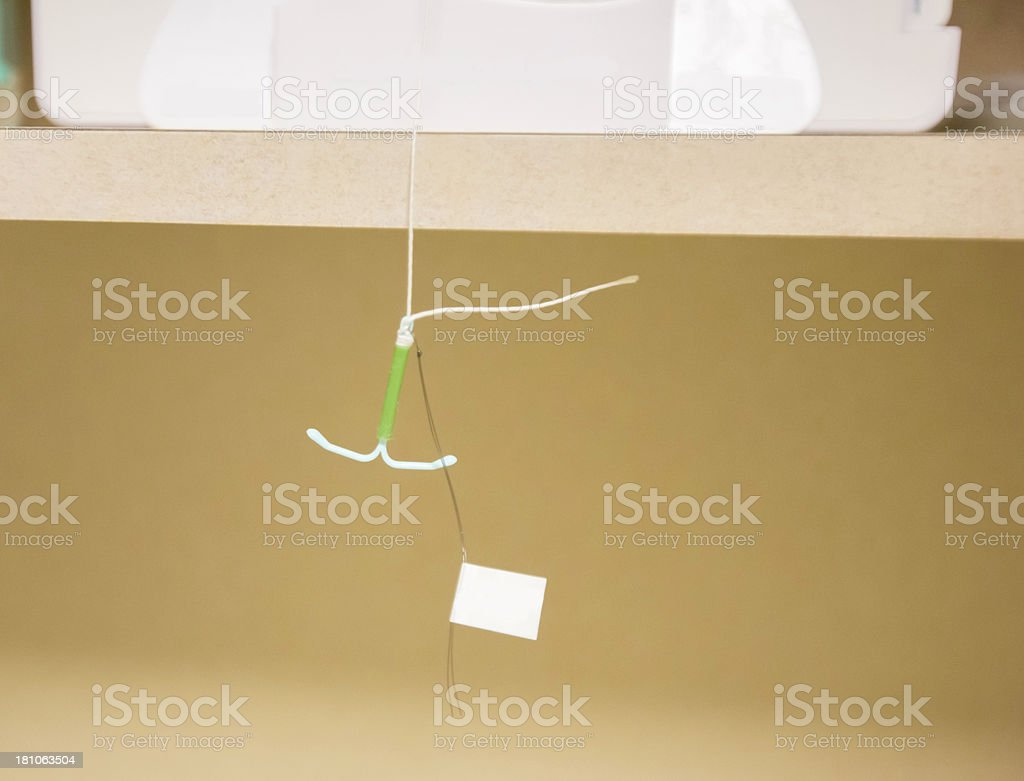 Model IUD- inter uterine device to stop pregnancy stock photo