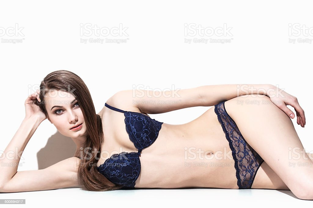 Model lying down and posing in underwear stock photo
