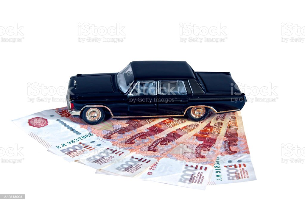 Model of a black car on Russian banknotes isolated stock photo