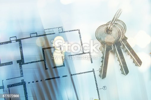 626187670istockphoto model of a house and key ring on a blueprint 877072666