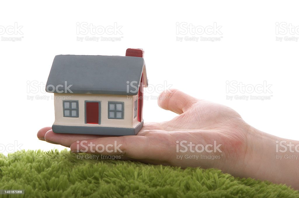 Model of a  house on hand royalty-free stock photo