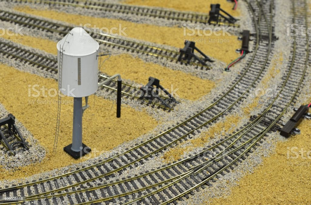 Model of a water tower on a model railway desert landscape stock photo