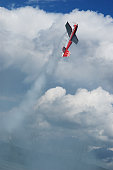 Model of acrobatic airplane Extra 330 diagonally climbing into the air