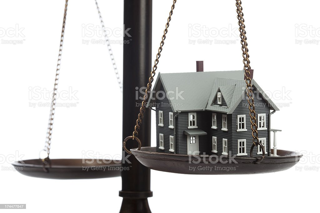 Model of house on scale stock photo