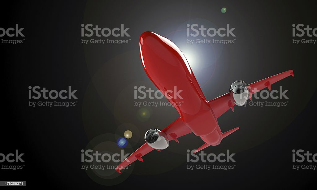 model of red airplane isolated on black sun glare royalty-free stock photo