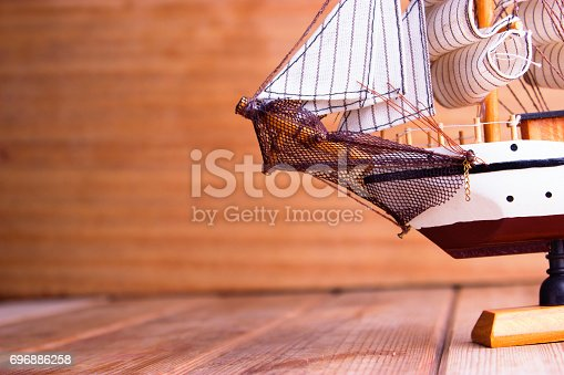 istock model of ships on the wooden table 696886258