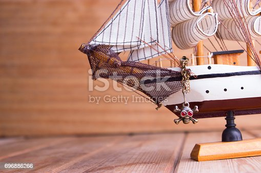 istock model of ships on the wooden table 696886266