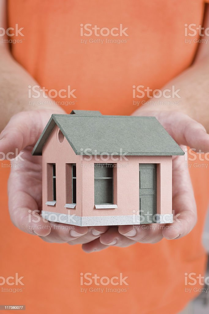 Model of the small house in human hand royalty-free stock photo