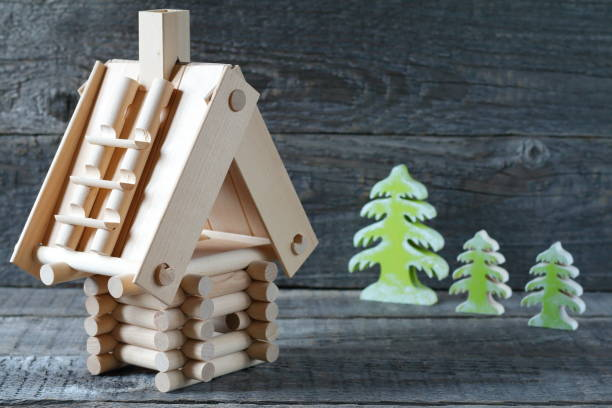Model  of  timber house. Model  of  log house on a gray wooden background. russian dacha stock pictures, royalty-free photos & images
