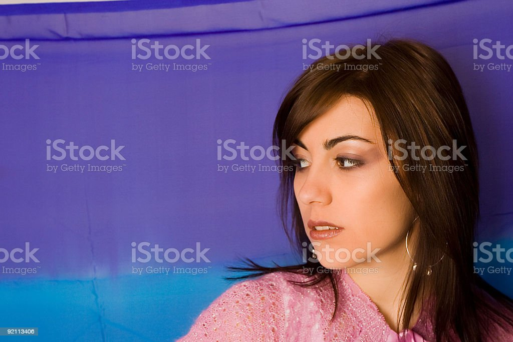 Model on a blue background with text area stock photo