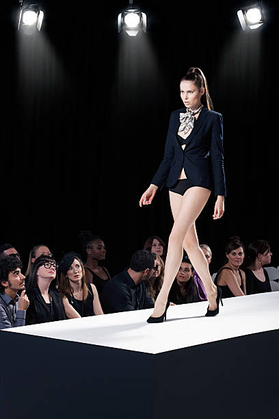 Model on catwalk at fashion show  ramp stock pictures, royalty-free photos & images