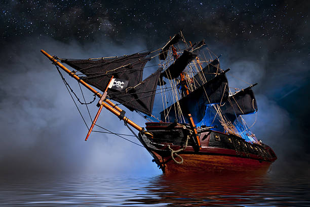 model pirate ship with fog and water - pirates stock photos and pictures
