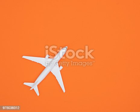 istock Model plane, Airplane on pastel color background, Flat lay design. 975038312
