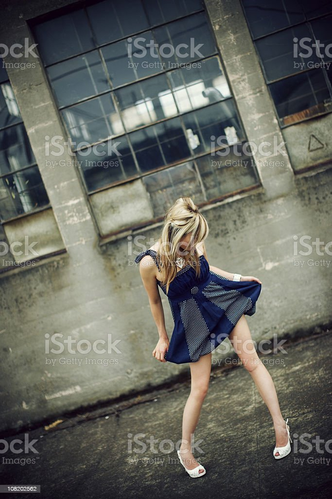 Model Playing with her Blue Dress royalty-free stock photo
